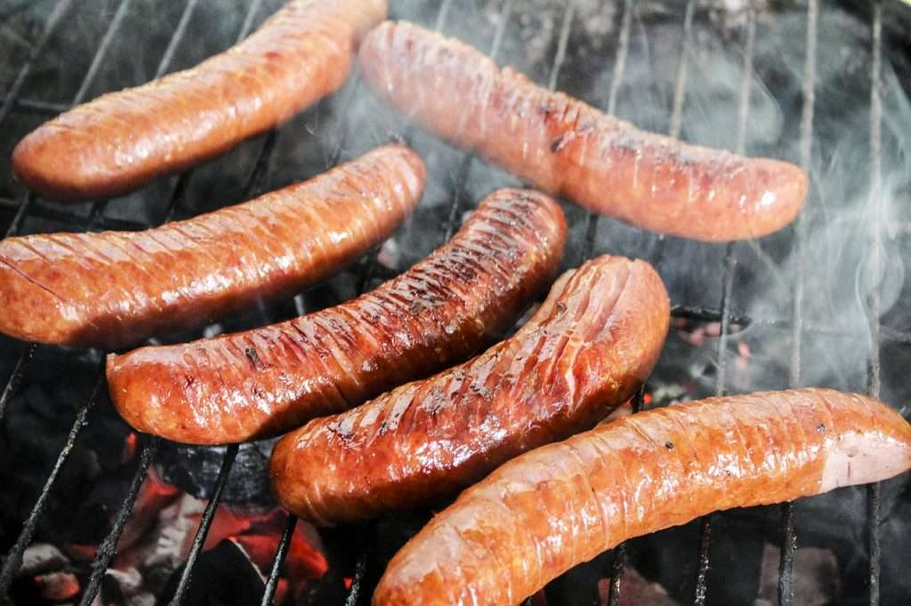 sausage cooked on the grill grates